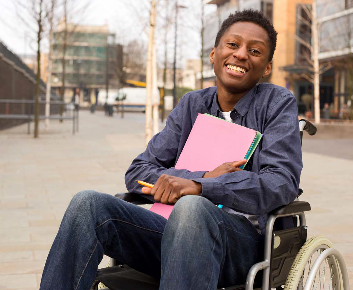 student in wheelchair, happy, holding folder